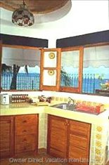 The Functional Kitchen Overlooks the Beach & Ocean.