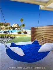 Relaxing on the Hammock - the Hammock is in Front of the 2nd Bedroom.