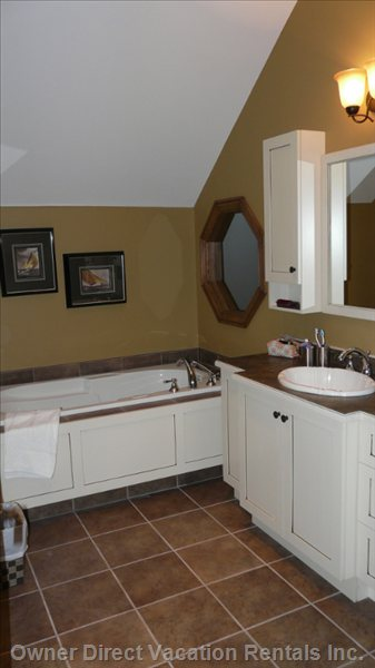 Master Bathroom - Whirlpool Bath and Spacious Vanity Area