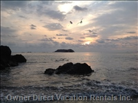 Parasails and Pelicans at Manuel Antonio Beach.