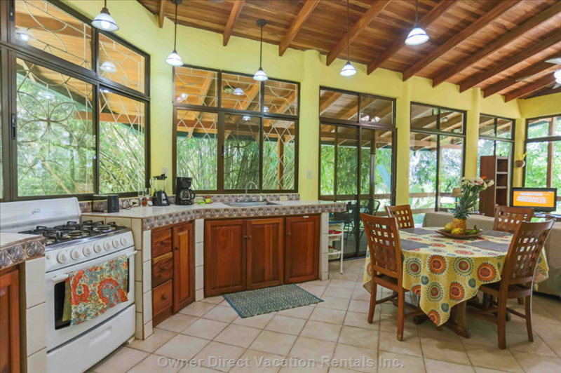 All the Comforts of Home in an Open Floor Plan with Windows to View Rainforest.