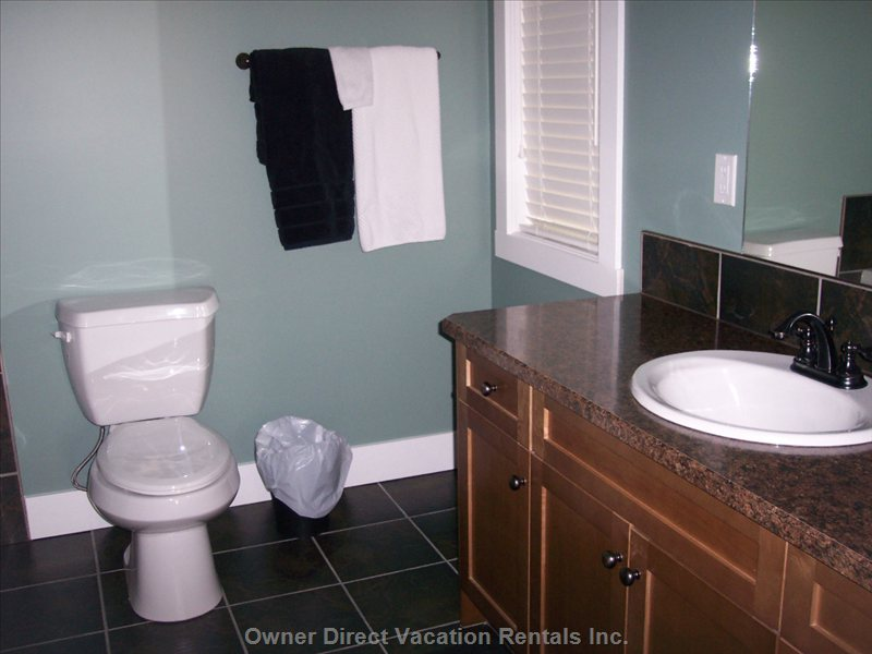 Ensuite, Contains Toilet, Sink, Soaker Tub and a Shower Stall.