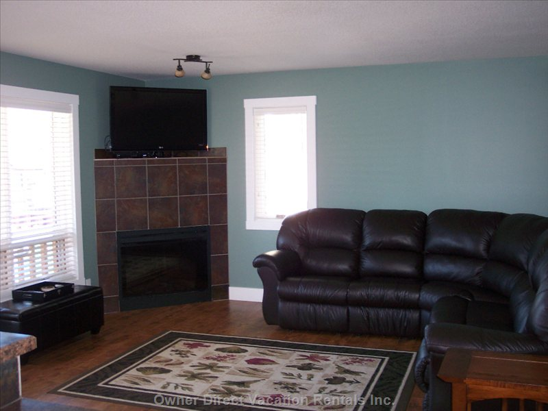 Living Room, Complete with Leather Sectional that Doubles as a Queen Size Hide-a-Bed, Satelite and Hd Tv.