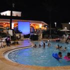 Dive in Movie at the Regal Palms - Watch a Movie While you Swim Or Hang at the Tiki Bar