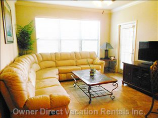 Large Family Room with Hdtv and Door Leading to Private Balcony