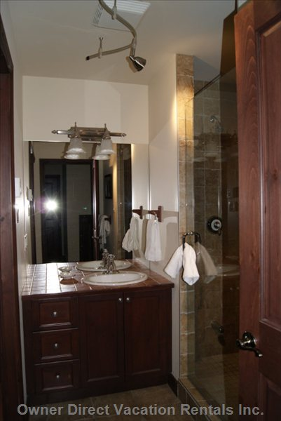 Bathroom - has a Jaccuzi Tub and Toilet Separate from the Vanity and Shower Area