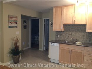 Kitchen Leads to a Full Bathroom and 2 Large King Size Bedrooms with Huge Closets