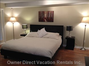 Master Bedroom with New Headboard, Tables, Dresser (Dec 14,2012) Privately Situated Away with its Own 42 Inch HD TV ,.
