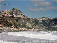 Big Waves at the Beach with Taormina on the Hill.