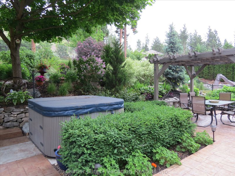 Hot Tub & Dinning Pergola in Part of the Lush Garden, a few Steps out the Door.