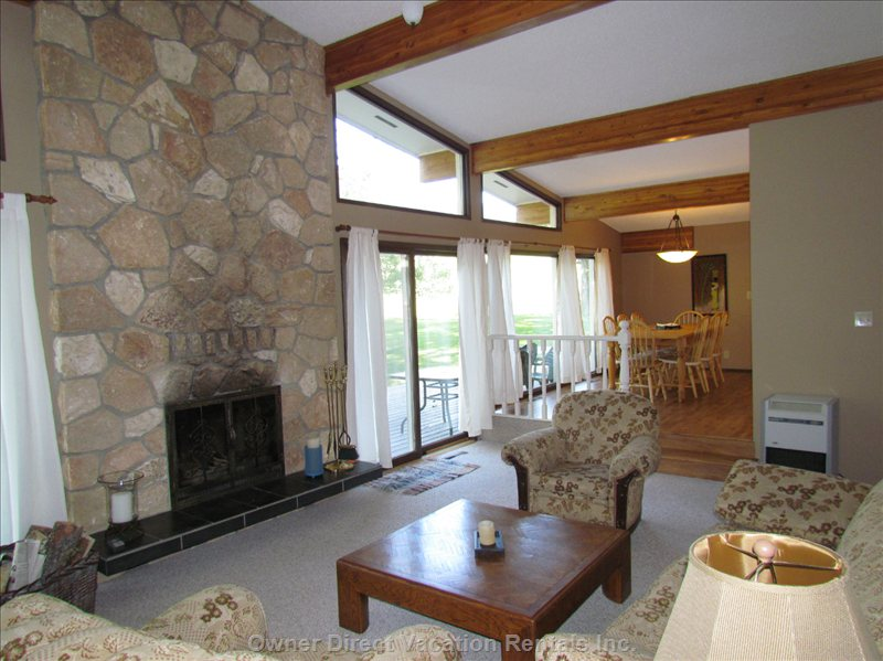 Family Room - Relax in Front of Fire in Open Beam Family Room.