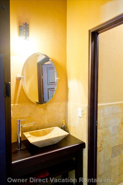 Powder Bath off Main Living Area. Fabulous Stone Tile Walls and Cedar Cabinets. Stone Sink. Private Toilet Room.