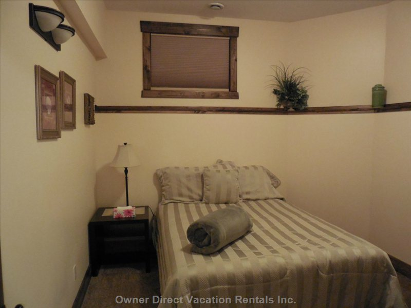 Lower Level Bedroom with Queen Bed, Closet, Electric Fireplace Heater and Everything you Need for a Good Night's Sleep, Enjoy!