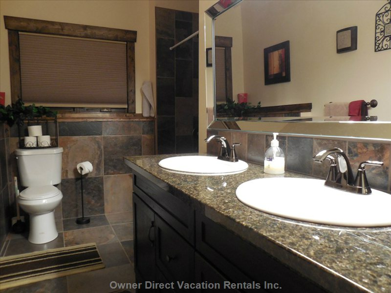 Lower Level Main Bathroom with Tub/Shower, Twin Sinks, Granite Countertops, Tiled Floors and Large Vanity for Plenty of Storage