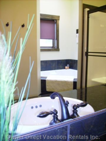 Master Bathroom~Tiled with Double Sinks, Separate Shower & Jetted Soaker Tub, European Style Separate Toilet Room