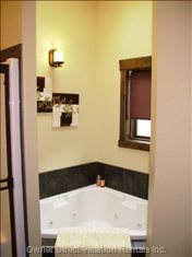 Jet Tub in Master Bathroom~Large Jetted Corner Soaker Tub with Skylight