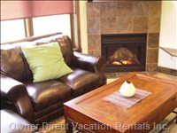 Lounging Area~Leather Couches, Books Available to Read by the Fireplace, Access to Front Balcony