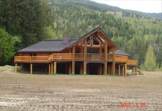 Luxurious Log Cabin with 20 Acres to Play in, on the Eagle River.