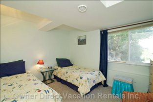 Room with 2 Twin Beds in 2 Bedroom Suite, this Room Also has a View of the Vineyard and Lake.