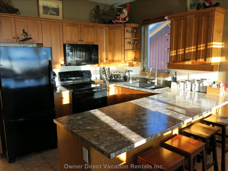 Bright and Spacious Kitchen with New Appliances and New Counter Tops,  well Equipped with all the Amenities for a Great Vacation