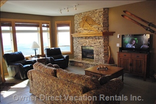 "Bright Living Room with 40"" TV, Blu Ray, DVD, Bose Stereo, Leather Recliners and Gas Fireplace. Door to Deck & 7 Person Hot Tub and Bbq"