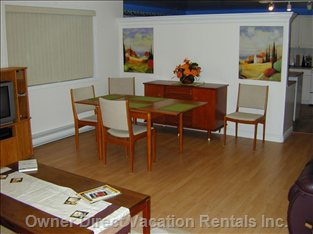 Living-Dining Area - this Picture Shows the Dining Area in Relation to the Kitchen. the Table Can Accommodate 6 People.