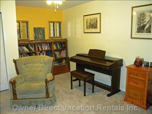 Den with Futon for Extra Guest - Sitting Area with Bookcase, Desk and Electronic Organ