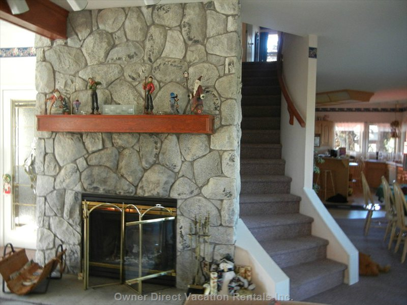 Real Log Fireplace and Stairs Going to the Bedroom Level