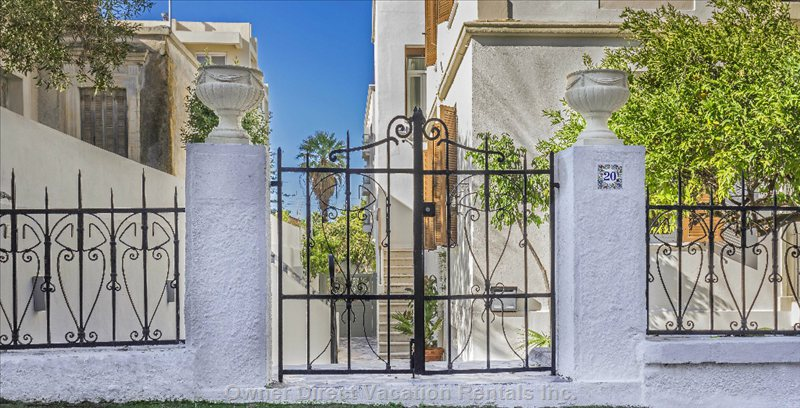 Enter the Wrought Iron Gates and Walk Downstairs to your Own Private Oasis.
