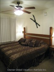 King Size Bed in Master Bedroom with Fan.  Sleep to the Peaceful Sounds of the River.