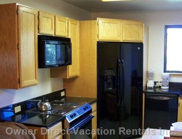 Kitchen has Full Size Appliances, Including Full Size Washer and Dryer.