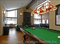 Enjoy a Game of Pool - Full Sized Pool Table Area with Wet Bar.