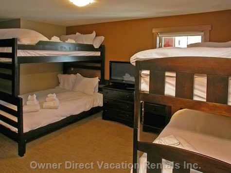 Family/Bunk Suite - Great Room for a Family Or Just Lots of Kids!  Double Bed over Queen Size Bed Bunk and Single Bunks (Sleeps 6). TV, Games Console, Bean Bags, and en-Suite Bathroom with Steam Shower Enclosure.