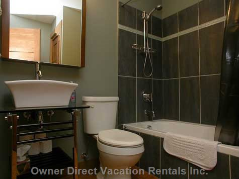 Family Bathroom - with Bath Tub and Shower.  Heated Cork Floor, Hairdryer and Fluffy Bath Towels.