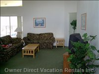 Open Floor Plan Living/Family Room Leads to Lanai & Pool.
