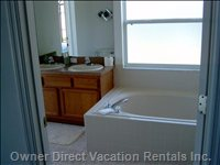 Master Bath with Large Soaking Tub and Shower off Pool.