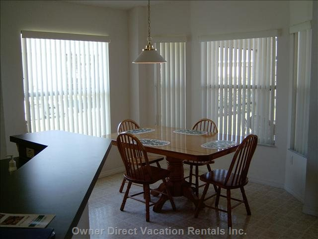 The Dinette Looks onto the Lanai/Pool Area.