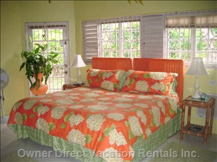2nd Master Bedroom on Main Floor with Private Bathroom.  View of the Banana Trees.