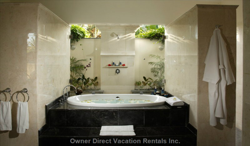 Bathroom in King Bedroom Suite. Completed with Bathtub, Indoor Shower and Garden Setting Outdoor Shower.