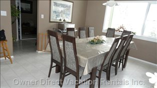 Large Dining Room - Table and Chairs (10); Open-Concept and Spacious for Large Groups.