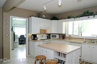 Bright Open Kitchen - a Dream to Work In.  Plenty of Room.  Island in the Middle is Equipped with Power plus Baking Tools.