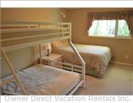 Spare Bedroom (Sleeps 5) - Lovely Bedroom Complete with Large Closet and Night Table.
