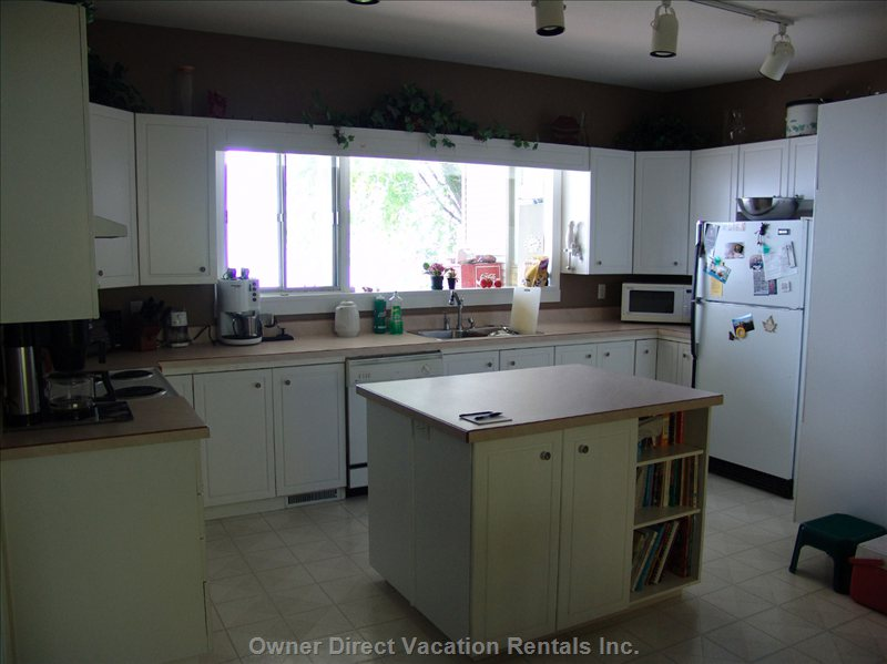 Lots of Space to Prep your Meals and a Large Window to Watch the Children Playing Outside on the Deck Or in the Yard