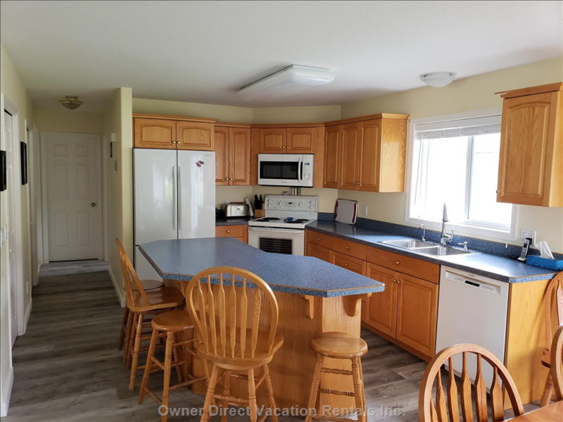 Fully Equipped Kitchen with Bbq Outside the Sliding Doors off the Dining Area.  Spices and Baking Supplies Available.