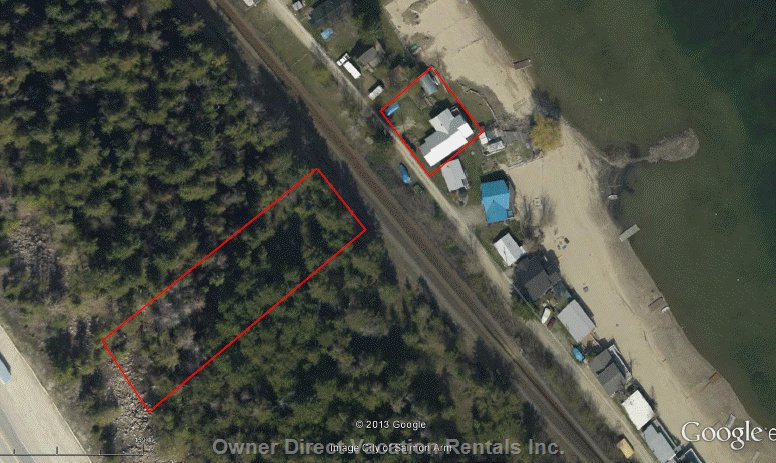 House is on the Beach and Property Includes a Large Expanse of Natural Wooded Area!
