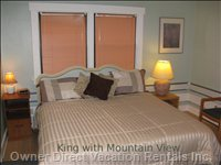 A King Bed -  in a Corner Unit with a Mountain View