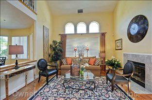 Formal Living with Fireplace & Cathedral Ceilings.