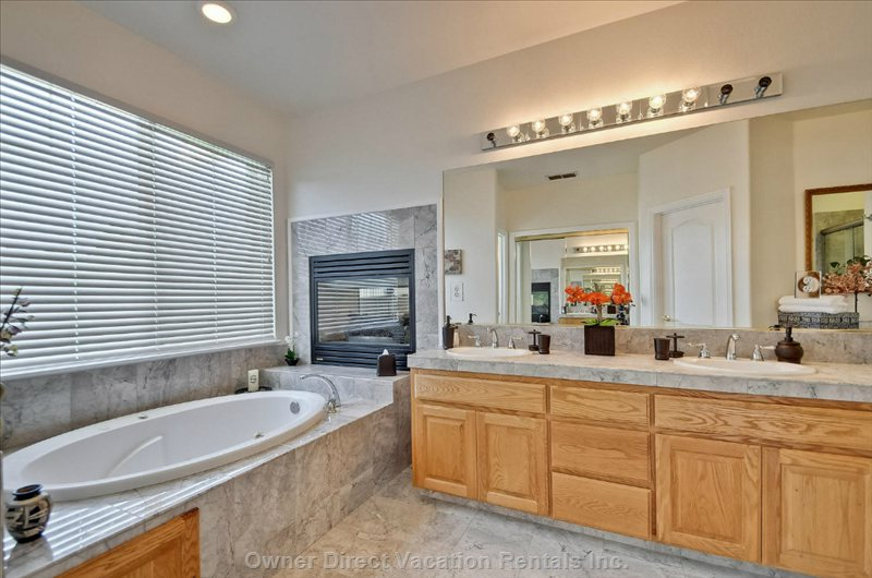 Master Bathroom with Jacuzzi Tub and Fireplace.