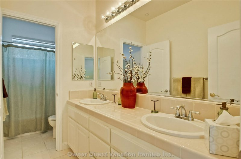 Shared Bathroom Upstairs has Private Bathtub/Shower.