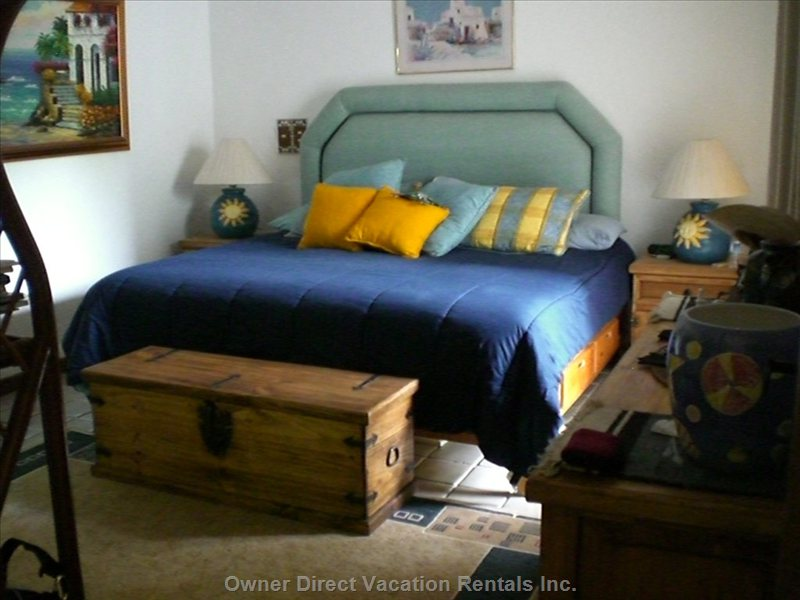 Spacious King Size Bed in a Large Bedroom - the Bedroom has a Secuirty Metal Slider Door that Access the Patio for Peaceful Night Sleeping.  There is a Double Dresser and an Armoir.